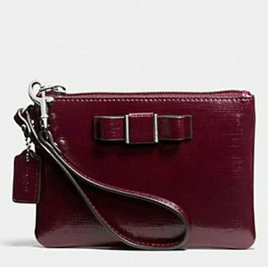 EUC COACH crossgrain leather Darcy Bow Wristlet